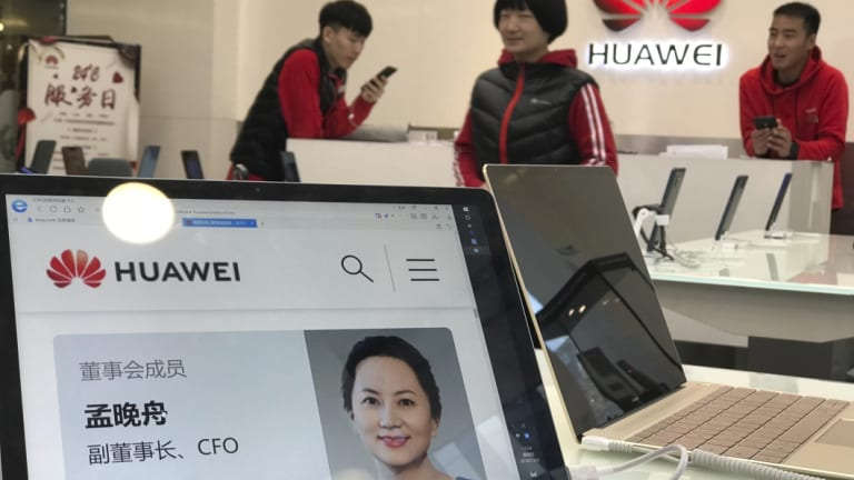 A profile of Huawei's chief financial officer Meng Wanzhou is displayed on a Huawei computer.