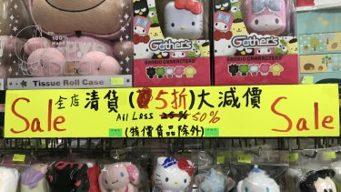 Lucas has had a shop at Mong Kok ladies' market for 23 years. Heput up the 50 per cent off sign because there were no tourists.