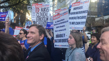 Nurses and midwives rallied outside NSW Parliament, calling for better nurse-to-patient ratios.