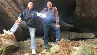 Geocachers Greg Shaw and Thomas Schulze emerge from the 'secret' cave in Pierces Creek Forest.