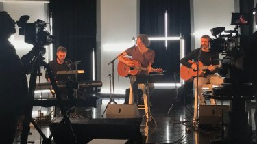 (L-R) Johnny McDaid, Gary Lightbody and Nathan Connolly of the Snow Patrol performing an intimate gig to promote new album Wildness at Studio Max, Foxtel, on Monday.