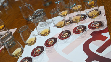 A whisky-tasting line-up in Scotland.