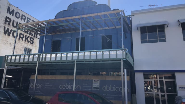 The building facade has been covered up and construction work is continuing.