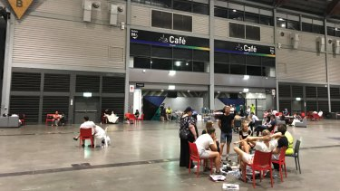 Temporary home: Affected residents inside the Sydney Showgrounds' exhibition hall late on Monday evening.