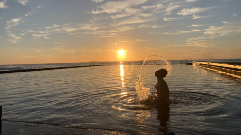 Sam, an early swimmer at Austinmer beach in Wollongong. Photo taken at sunrise with the new Apple iPhone Xs Max.