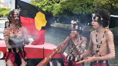 Quandamooka songman Josh Walker and indigenous dancers welcome guests aboard Australia's first-ever indigenous whale-watching boat.