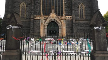 Ribbons tied to the gates of St Patrick's Cathedral on Tuesday night.
