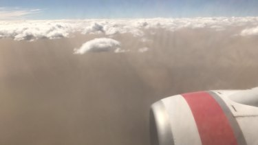 The dust storm over Canberra from a Virgin Australia flight, which had to abort its first landing attempt on Tuesday afternoon because of wind.