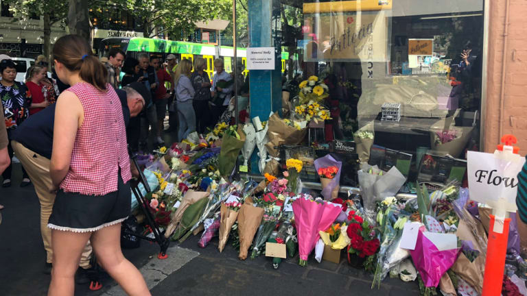 Flowers left outside Pellegrini's in Bourke Street in memory of attack victim Sisto Malaspina.