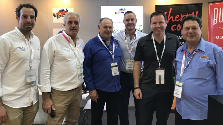 Andrew Broad pictured with Australian fruit producers at a conference in Hong Kong.