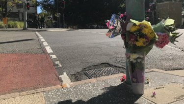 Flowers were laid at the intersection between Ann and Wharf streets where a woman died after she was accidentally hit by a bus.
