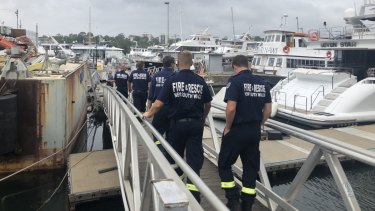 Hazmat crews arrive at the All Occasion Cruises moorings to conduct testing earlier this year.