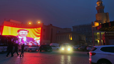 A large image of Chinese President Xi Jinping is beamed in a square in Kashgar, an ancient city in Xinjiang, north-west China.