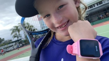 Security researcher Troy Hunt's six-year old daughter Elle with a TicTocTrack smartwatch.