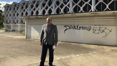Councillor Charles Strunk outside the derelict building in 2018.