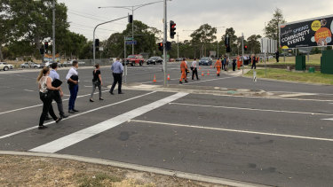 Police and SES do a line search from a Bundoora tram stop to where a woman's body was found on Wednesday morning.