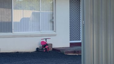 A tricycle remained at the front of the house on Tuesday morning.