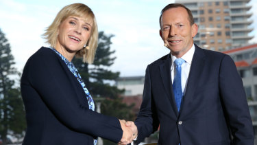 Warringah candidates Zali Steggall and Tony Abbott shake hands ahead of their debate.