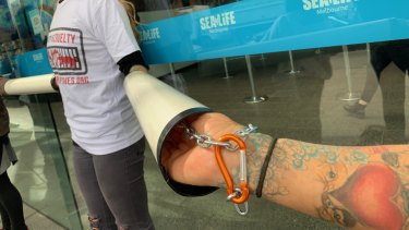 Protesters linked together with pipes and chains outside Melbourne Aquarium.