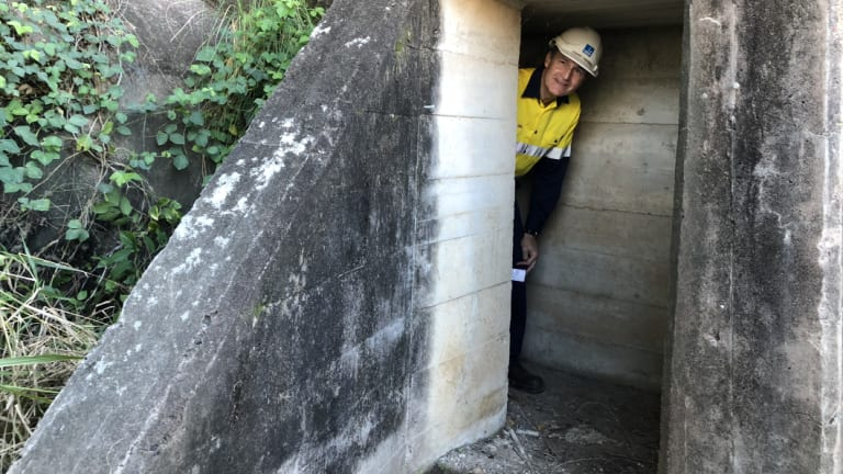 Lord mayor Graham Quirk in one of the air-raid shelters uncovered at the Howard Smith Wharves development.