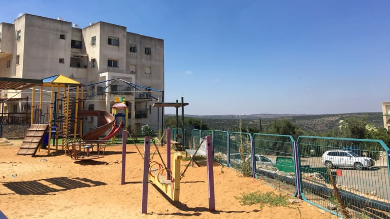 A segregated children's playground in the settlement of Emmanuel.