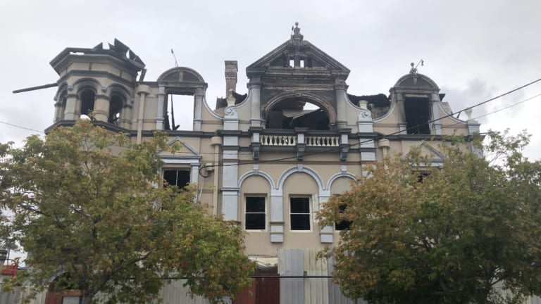 """The abandoned hotel on Logan Road at Woolloongabba was damaged by a third blaze, which police are treating as """"suspicious""""."""
