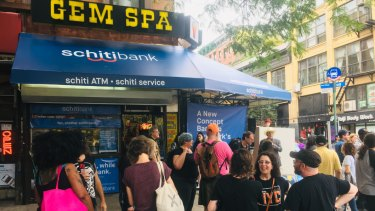 """Scenes from a """"cash mob"""" at the Gem Spa corner store."""