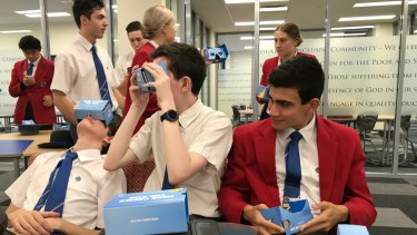 Southern Cross Catholic College students (from left) Oliver Sims, Max Fallon and Riley Diaz look at a 3D view of Queensland's newest university.