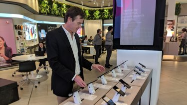 Phil, browsing smartphones, says a new Huawei operating system would not be appealing to him.