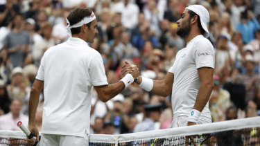 No sweat: Roger Federer shakes hands with Matteo Berrettini after easing past the Italian.