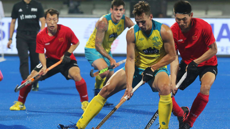 Australia's Tom Craig  in action against Meng Dihao (R) of China during the men's Field Hockey World Cup match between Australia and China.