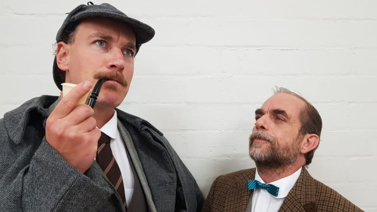 Philip Meddows as Sherlock Holmes and Peter Fock as Dr Watson in Tempo Theatre's production of <i>The Hound of the Baskervilles</i>.