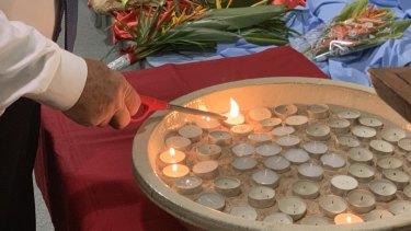 Candles were lit for the victims.