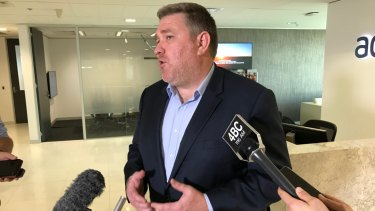 Adani's chief executive Lucas Dow speaking with reporters about the company's Carmichael Mine application.