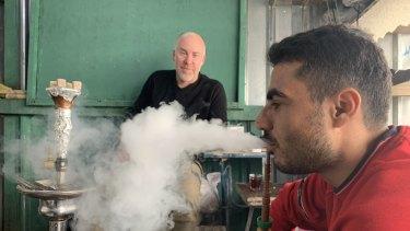 Stranded in Iraq: Michael Bachelard (left) interviews Issa Abdulqadir in a refugee camp in Iraqi Kurdistan.