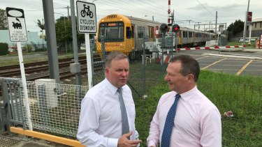 Labor frontbencher Anthony Albanese and federal MP for Moreton Graham Perrett announce $73 million as a share of the $210 million to replace the Coopers Plains rail crossing with an overpass.