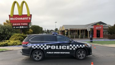 Police took cover inside McDonald's in Sunbury when their patrol car was shot at and rammed.
