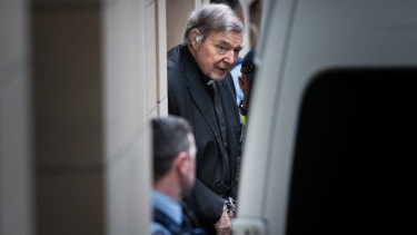 Paedophile George Pell leaves Melbourne's Supreme Court building in handcuffs on Wednesday.