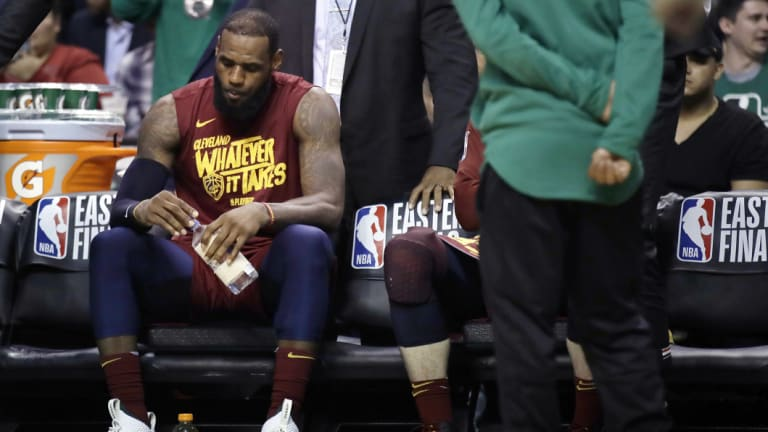 Cleveland's LeBron James sits on the bench.