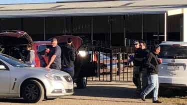 Police raid the stables of horse trainer Darren Weir on Wednesday.