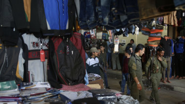 Members of the Kurdish internal security forces patrol at a popular market, in Manbij, north Syria in March.