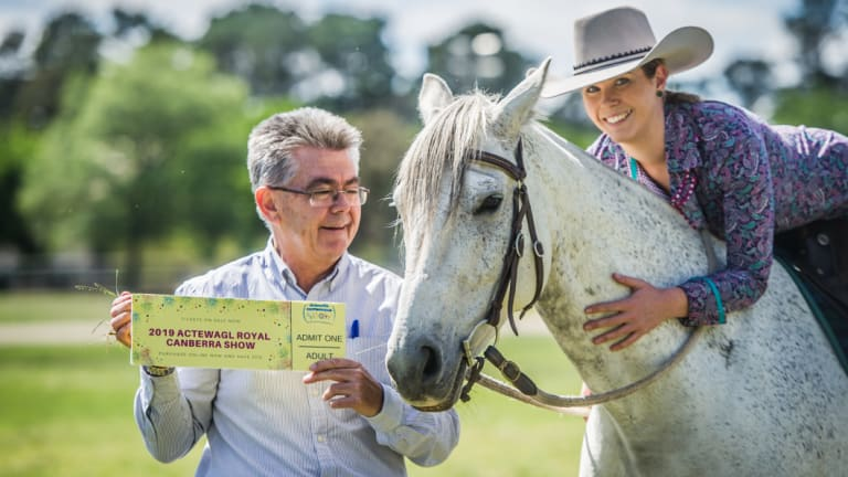 New Royal Canberra Show chief executive Athol Chalmers and chief horse steward Brooke Keir, with Izzie the horse and a cheaper ticket to next year's show.