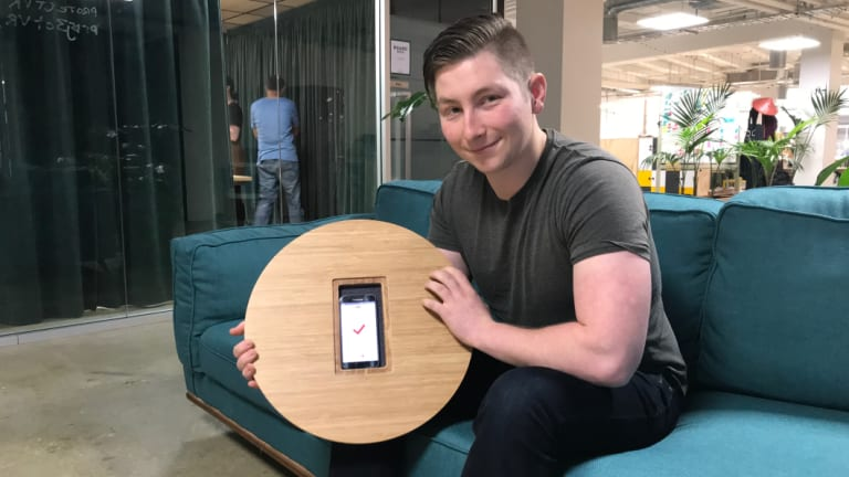 Swibo CEO Ben Dunn holds up its wobble board.