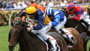 Aristia ridden by Damian Lane (yellow cap) wins race 2 the Mumm Wakeful Stakes during the AAMI Victoria Derby Day.