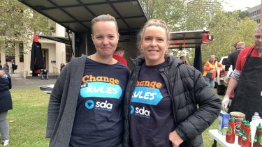 Waitresses Amy, 36, and Virginia, 42, outside Trades Hall before the Change the Rules rally in Melbourne's CBD.