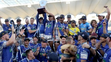 Newtown Jets celebrate their grand final win at Bankwest Stadium.