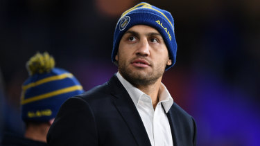 Keen spectator: Blake Ferguson watches on from the sideline during the Eels' clash with the Knights at Bankwest Stadium.