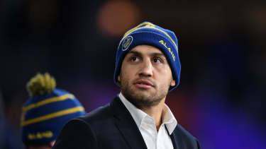 Blake Ferguson watches on from the sideline during the Eels' clash with the Knights at Bankwest Stadium.