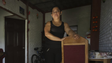 Rosa Ramirez poses for a photo at her home in San Martin, El Salvador.