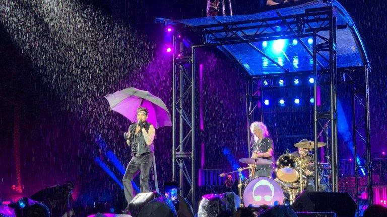 No thunderbolts and lightning, but plenty of rain as Queen rocks Brisbane